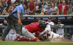 The Twins' Trevor Larnach was tagged out by Angels catcher Max Stassi in the second inning Thursday night at Target Field.