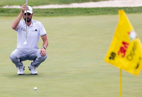 Troy Merritt lines up a shot on the 18th hole during the first round of the 3M Open golf tournament, Thursday, July 22, 2021, in Blaine, Minn. (Carlos