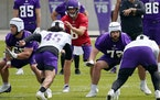 Vikings quarterback Kirk Cousins (8) with his offensive line during an offseason practice.