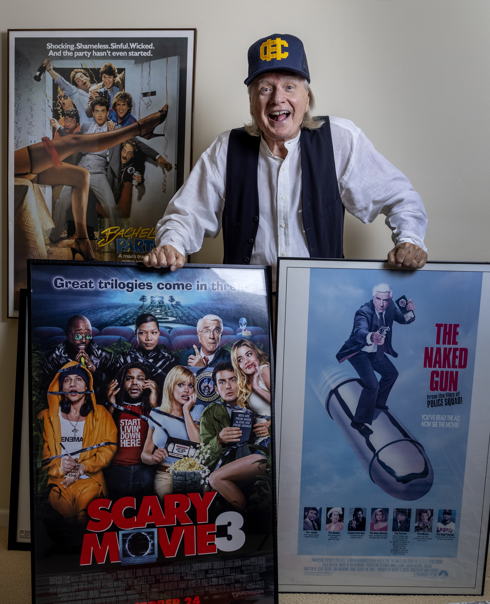 Writer Pat Proft photographed with movie posters from some of the films he has worked on.