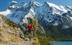 Biking near the glacial Lake Minnewanka in the Banff area.