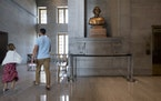 Visitors walked past a bust of Confederate general and early Ku Klux Klan leader Nathan Bedford Forrest at the State Capitol Thursday, July 22, 2021,