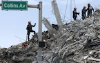 Search and rescue operations resume as members of the Pennsylvania Search and Rescue team comb through the debris several after hours after the Champl