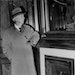 J.H. Prior, Charles Prior's son, inside the house just before its demolition in 1941.