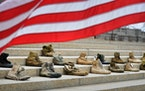 Pairs of boots sit on the front steps of the Capitol in St. Paul in 2017 to honor veterans and active-duty soldiers who die by suicide.