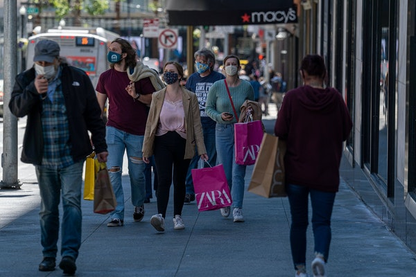 Shoppers are seen in San Francisco earlier this summer. The U.S. GDP is on course to jump 6.6% this year.