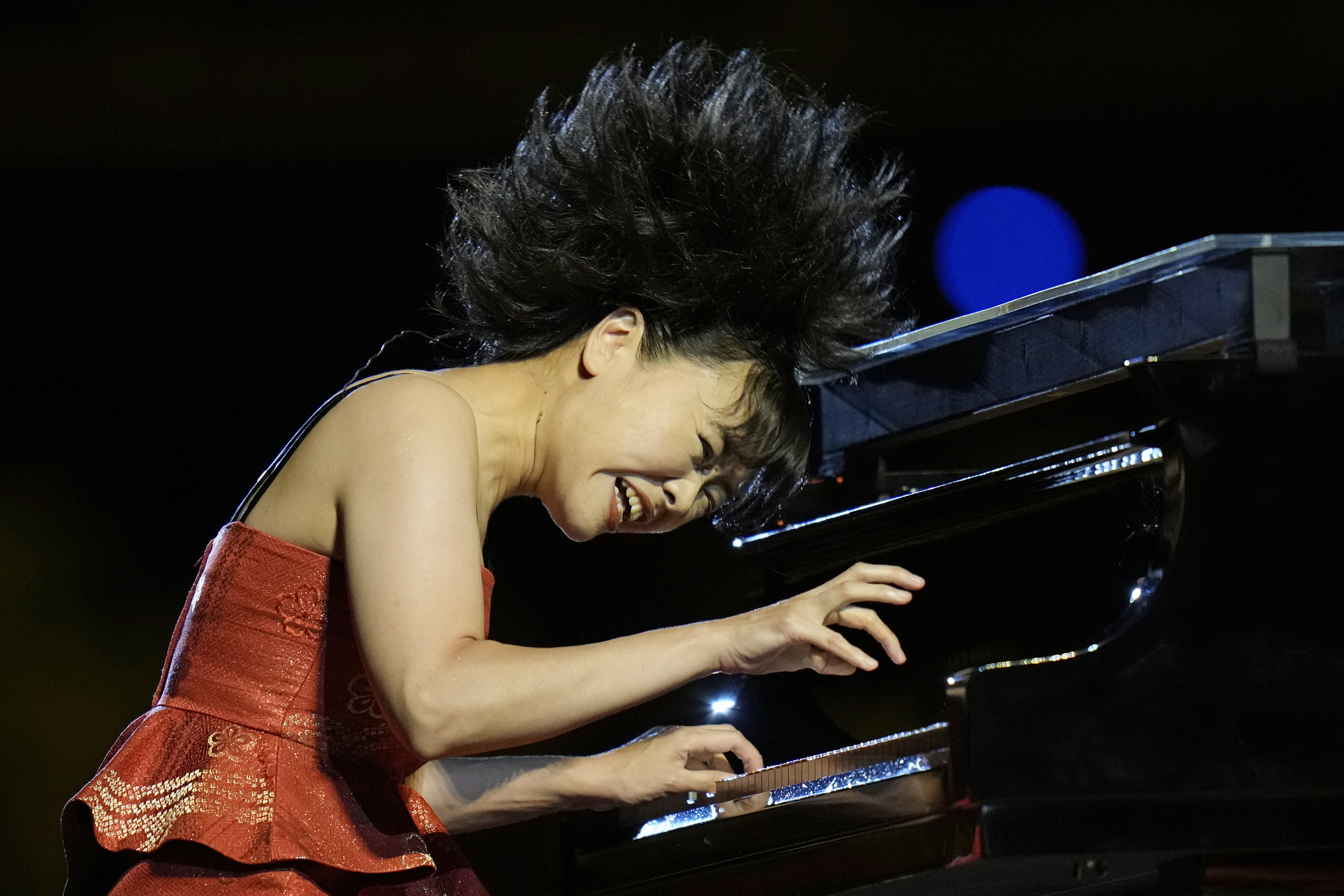 The pianist Hiromi performs at the Opening Ceremony.