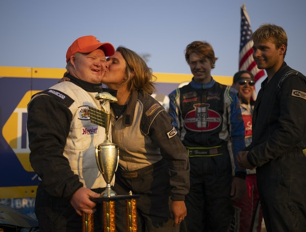on track: Ashley Mehrwerth gave friend and fellow driver TJ Inderieden a smooch on the cheek after the trophy presentation on victory lane following h