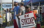 Kym Lewis, a Frito-Lay employee, stood on the strike line Thursday outside the Topeka plant. The workers have been on strike since July 5, but a settl