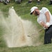Dustin Johnson hit his second chip shot out of the bunker just off the ninth green at TPC Twin Cities on Friday. The world's No. 2 golfer missed the