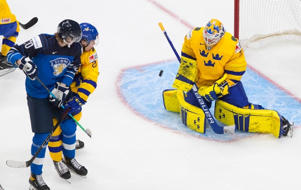 Sweden goalie Jesper Wallstedt made a save on Finland's Samuel Helenius in January at the world junior hockey championship.