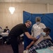 A patient, right, after receiving a COVID-19 vaccine at a vaccination site at Greater Emmanuel Institutional church in Detroit, on March 27, 2021. Bid