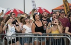 Concert-goers sang along to Brett Young at the Twin Cities Summer Jam at Canterbury Park in Shakopee, Minn., on Friday.