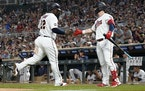 Ryan Jeffers congratulated Miguel Sano after Sano scored on a hit by Nick Gordon to pull the Twins within a run Friday night. Jeffers, Sano and Gordon