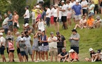 Fans lined up along the ninth fairway during Friday's second round of the 3M Open at TPC Twin Cities.