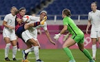 United States' Tobin Heath, second from left, battles for the ball against New Zealand's Abby Erceg.
