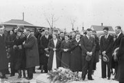 Mourners gathered at the grave of Laura Kruse, whose body was found March 20, 1937, in the snow behind a house on 14th Avenue S. in Minneapolis. The 1