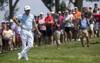 Rickie Fowler waited to putt at the 10th hole during the third round of the 3M Open on Saturday.