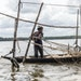 Onitsha Joseph headed out with her fishing nets near Warri, Nigeria, where the water and land have been fouled by decades of oil extraction.