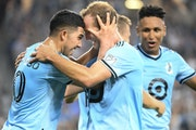 Minnesota United midfielder Emanuel Reynoso, left, celebrated with Chase Gasper after the Loons took a 2-1 lead against Portland on Saturday night.