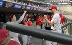 Patrick Sandoval was greeted in the dugout by Shohei Ohtani after getting pulled in the ninth inning against the Twins on Saturday night at Target Fie