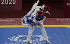 Kimia Alizadeh Zonoozi, Refugee Olympic Team, right, was attacked by Britain's Jade Jones during the taekwondo women's 57kg match Sunday.
