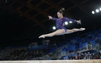Suni Lee, of the United States, performs on the balance beam during the women's artistic gymnastic qualifications at the 2020 Summer Olympics on Sun