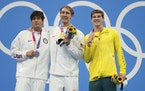 Gold medalist Chase Kalisz, center, celebrates on the podium with silver medalist and teammate Jay Litherland, left, and bronze medalist Australia's