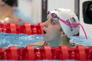 Regan Smith of United States looks up following her heat in the women's 100-meter backstroke at the 2020 Summer Olympics, Sunday, July 25, 2021, in