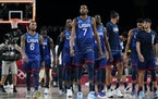 United States' Kevin Durant (7) walks off the court with teammates after a men's basketball preliminary round game against France at the 2020 Summ