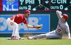 The Angels' Shohei Ohtani was tagged out at second on a steal attempt by Twins shortstop Andrelton Simmons in the first inning Sunday.