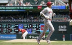 The Angels' Shohei Ohtani jogged home after his solo home run off Twins reliever Danny Coulombe in the sixth inning Sunday.
