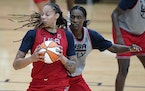 Sylvia Fowles of the Lynx, right, guards Brittney Griner at U.S women's basketball team practice this month.