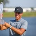 Cameron Champ lifted the 3M Open trophy at the TPC Twin Cities in Blaine on Sunday, after shooting a final-round 66 to win by two strokes.