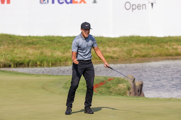 Cameron Champ celebrated after making his final putt at the 18th hole to win the 3M Open at TPC Twin Cities in Blaine on Sunday.