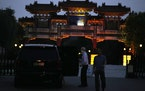 A man exits a U.S. embassy car outside the Tianjin Binhai No. 1 Hotel where U.S. and Chinese officials are expected to hold talks in Tianjin municipal