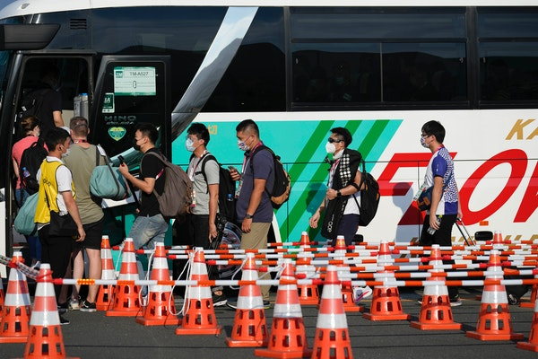 Ah, yes, a line for a bus — a common sight at the Tokyo Olympics.