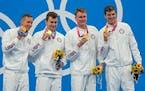 From left, the winning U.S. men's 4x100 freestyle relay team of Caeleb Dressel, Blake Pieroni, Bowe Becker and Zach Apple.