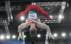 Shane Wiskus, of United States, performs on the parallel bars during the artistic men's team final at the 2020 Summer Olympics, Monday, July 26, 2021,