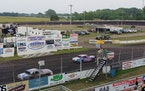 Racecars take the checkered flag Friday night at Fairmont Raceway in Fairmont, Minn.