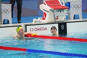 Ariarne Titmus of Australia, left, edged out the United States' Katie Ledecky for the gold medal in the women's 400-meter freestyle final in Tokyo