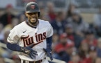 Twins star Byron Buxton reacted after getting hit by a pitch against Cincinnati on June 21. The pitch broke his left hand, and Buxton hasn't played