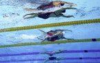 Regan Smith, top, won the bronze medal in the 100-meter backstroke final at the 2020 Summer Olympics, Tuesday.