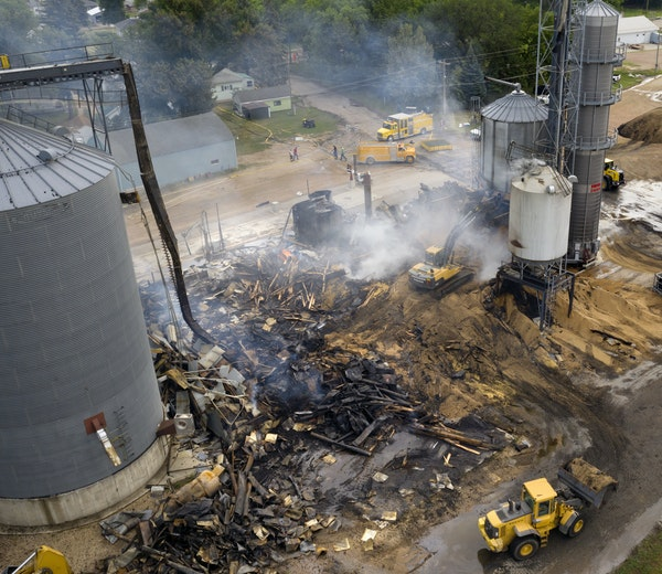 Salvage crews and volunteer firefighters cleaned up what was left of the grain elevator in Clinton, Minn., on Monday, July 26.
