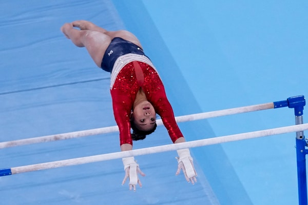 St. Paul's Suni Lee posted Team USA-best scores on three of the four events Tuesday night in Tokyo, including uneven bars, after star Simone Biles l