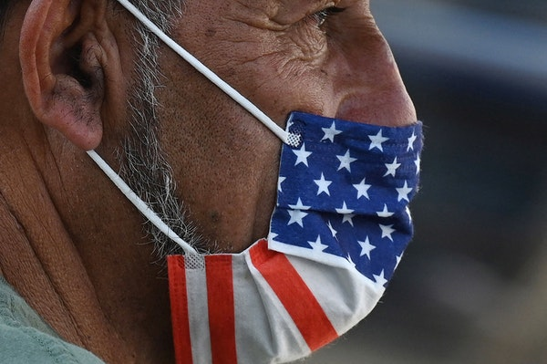 A man wore a U.S. flag face mask on July 19, 2021, in Hollywood, on the second day of the return of the indoor mask mandate in Los Angeles County due