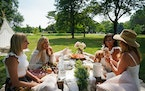Friends enjoyed a picnic set up by Courtney Smallbeck, owner of Perfect Picnic Co., in Lyndale Park. From left, Sandy Long, Angela Kostel, Nardos Sium
