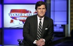 """Tucker Carlson, host of """"Tucker Carlson Tonight,"""" poses for photos in a Fox News Channel studio, in New York."""