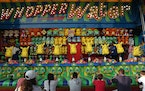 Fairgoers played the Whopper Water game in the Mighty Midway section on opening day of the 2017 Minnesota State Fair.
