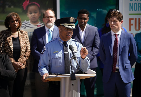 Minneapolis police chief Medaria Arradondo, at podium, and Minneapolis Mayor Jacob Frey, right, joined other city leaders in announcing a new model fo